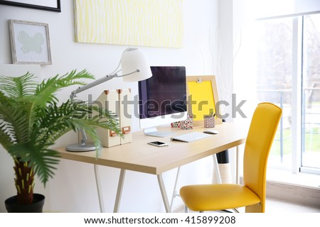 Stylish workplace with computer at home #415899208