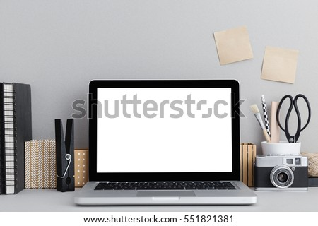 Stylish workspace with  laptop computer, office supplies, camera, sticky notes at home or studio