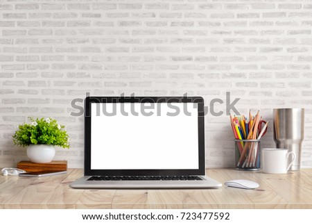 Stylish workspace with laptop computer, office supplies gadget at home or studio office. Desk space Mock up blank screen for graphic montage.