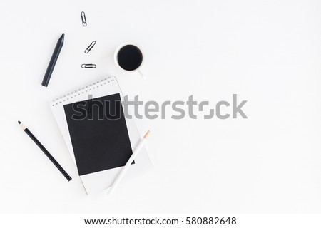 Stylish workspace with notebook, cup of coffee, paper blank, pencils. Business concept.  Flat lay, top view. #580882648