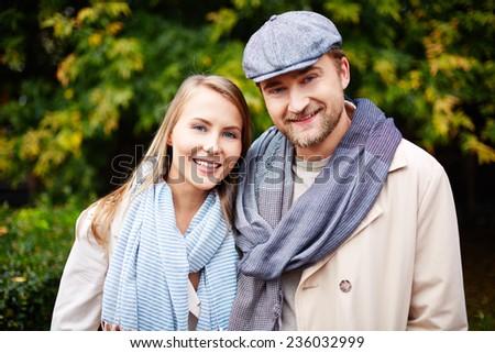 Stylish young man and woman looking at camera