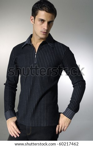 Stylish young man posing and looking at camera isolated