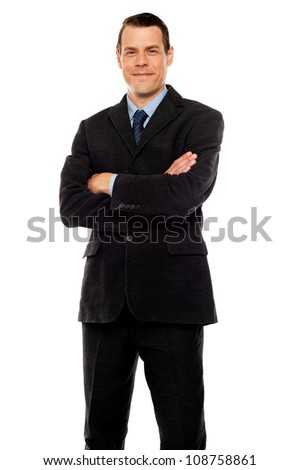 Stylish young man posing with crossed arms. Business concept