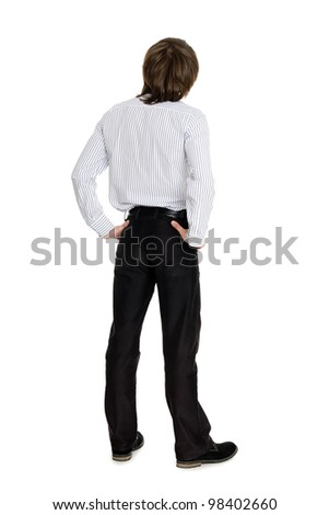 Stylish young man standing with his back looking up