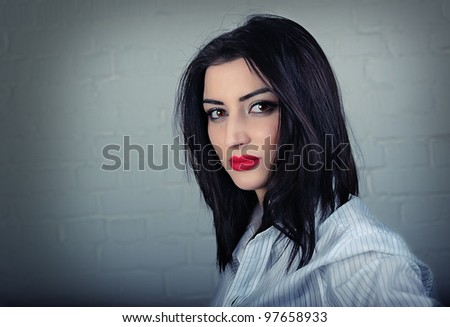 Stylish young woman dramatic portrait