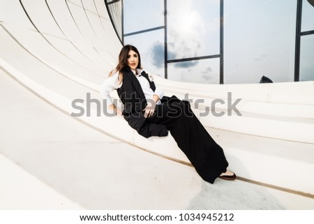 stylish young woman posing at the camera