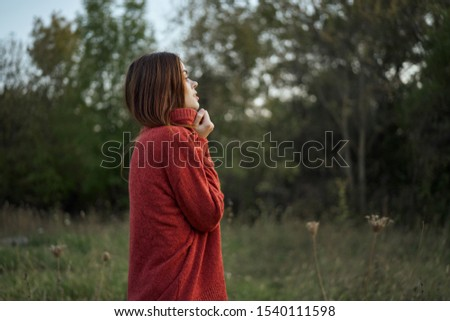 stylish young woman walks the earth stylish model #1540111598