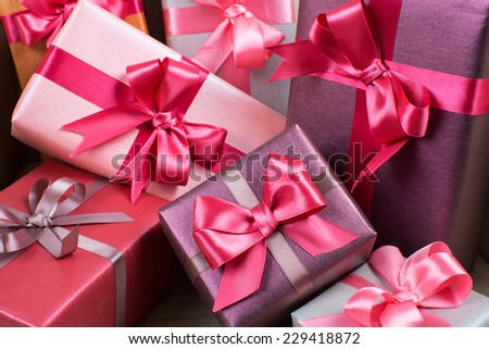Stylishly packaged boxes with gifts closeup