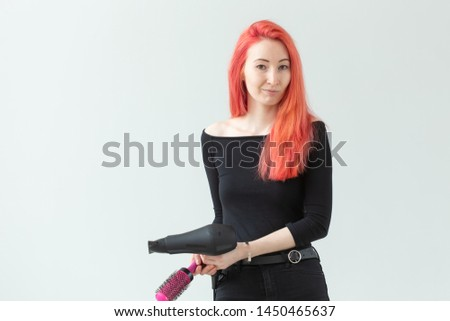 Stylist, hairdresser and people concept - Professional hairdresser with hair dryer on white background with copy space
