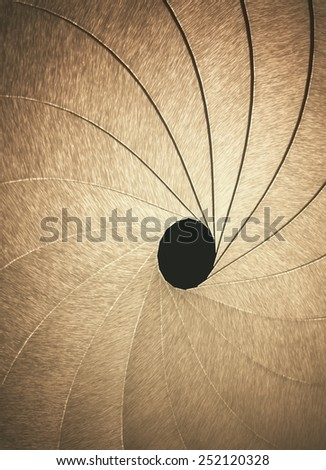 Stylized aperture blades exposed with depth of field in the hole.