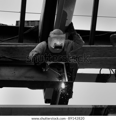 Stylized Black and White of Arc Welder Working at Construction Site - stock photo