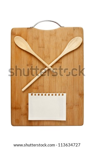 stylized clock - cutting board and wooden spoons isolated on a white background