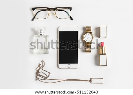 Stylized feminine flatlay with glasses, lipstick, perfume, watch, pendant  and smart phone mock up isolated on white top view. Woman accessories from above copy space for text.  #511152043