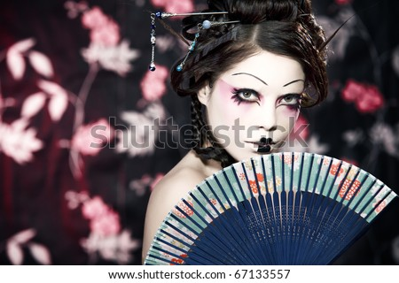 stock photo stylized picture of a Japanese geisha makeup done by