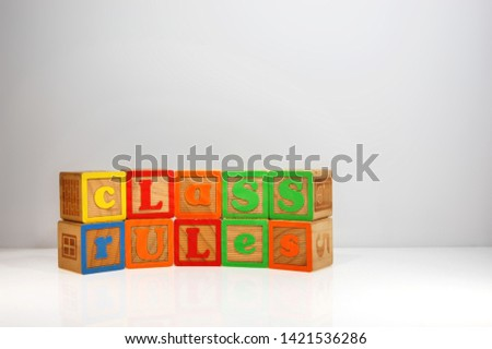 "Stylized shot of ""Class Rules"" spelled out with ABC blocks."