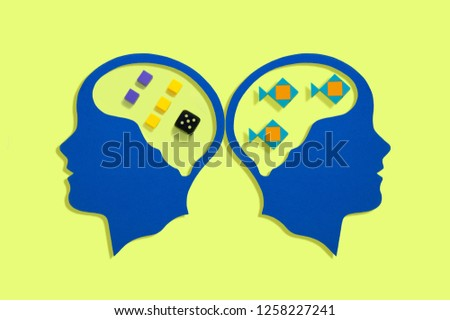 Stylized silhouettes of head. Symbolic image of work of brain. Left hemisphere is responsible for logical processes. Right hemisphere is responsible for holistic images. Minimal psychological concept #1258227241