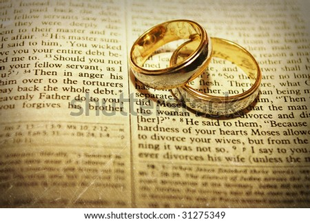 stock photo Stylized Wedding Rings on a Bible