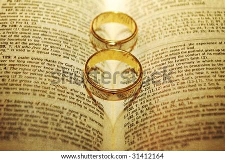 stock photo Stylized Wedding Rings on a Bible