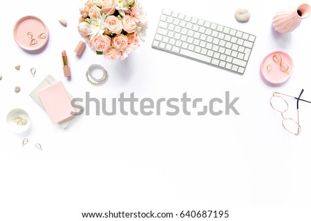 Stylized women's desk, office desk. Workspace with, laptop, bouquet roses, clipboard. Women's fashion accessories isolated on white background. Flat lay Top view