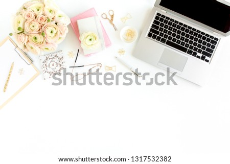 Stylized women's home office desk. Workspace with laptop, computer, bouquet ranunculus and roses, clipboard, feminine golden fashion accessories isolated on white background. Flat lay. Top view.  #1317532382