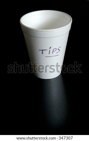 Styrofoam glass for tips. Empty.