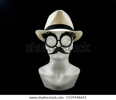 Styrofoam head with a straw male summer hat and glasses with moustache on black background front view