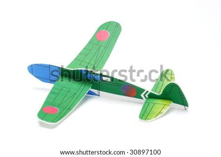 Styrofoam toy airplane on white background