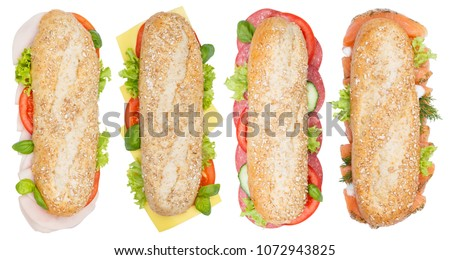Sub sandwiches whole grains baguettes with ham salami cheese salmon fish from above isolated on a white background