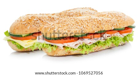 Sub sandwiches with ham and cheese whole grains grain baguettes isolated on a white background