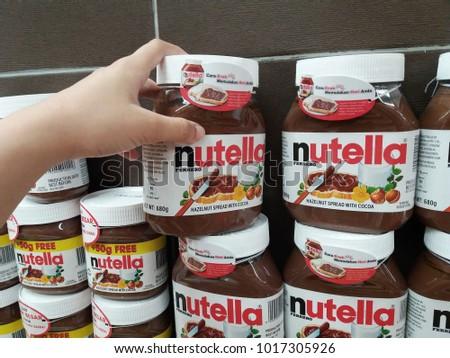 subang jaya malaysia 3rd february 2018 hand pick up a nutella