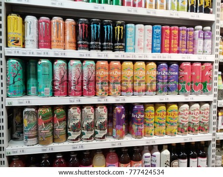 Subang Jaya , Malaysia - 17th December 2017 : Selection of assorted Arizona flavour drinks can on the shelves in a supermarket.Mobile photoghpy.     #777424534