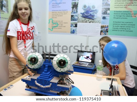 SUBANG JAYA - NOVEMBER 10: Unidentified Russian students shows a robot to people to exercise their eyes to improve vision at the World Robot Olympaid on November 10, 2012 in Subang Jaya, Malaysia.