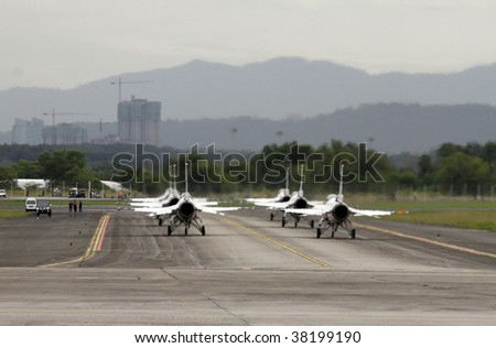 SUBANG, MALAYSIA - OCTOBER 3: Thunderbirds 1 to 6 taxiing down the runway for take off at the Thunderbirds airshow on October 3, 2009 in Subang, Malaysia.