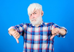 Subculture attributes. Emo subculture. Senior man with long bangs and beard. Mature hipster unusual appearance. Subculture and lifestyle. Barbershop and hairstylist. Expressing himself hairstyle.