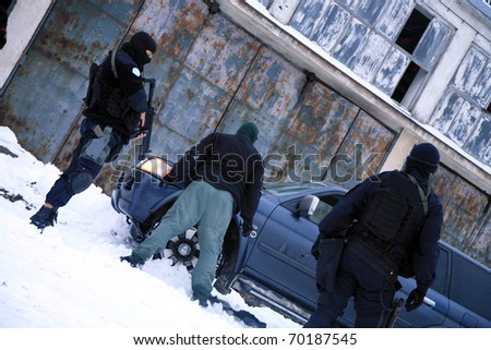 Subdivision anti-terrorist police during a black tactical exercises. Stopping the suspected vehicle and drivers. Real situation.