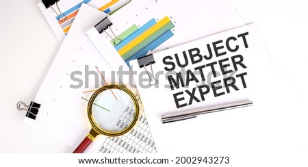 SUBJECT MATTER EXPERT text on white paper on light background with charts paper Stock photo ©