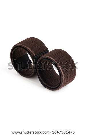 Subject shot of a brown hairdo-shaper hairagami. The rolled hair-bun maker is isolated on the white background.