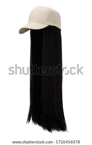 Subject shot of a natural looking black wig attached to a white baseball cap. The cap with the long straight wig is isolated on the white background.  ストックフォト ©