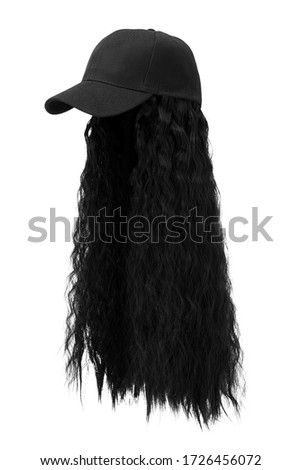 Subject shot of a natural looking black wig with wavy strands attached to a black baseball cap. The hat with the wig is isolated on the white background.  ストックフォト ©