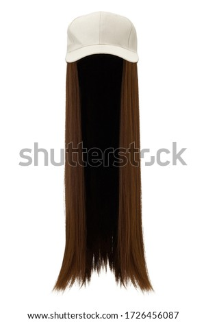 Subject shot of a natural looking brown wig attached to a white baseball cap. The cap with the long straight wig is isolated on the white background.  ストックフォト ©