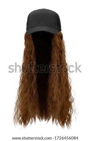 Subject shot of a natural looking brown wig with wavy strands attached to a black baseball cap. The hat combined with the wig is isolated on the white background. ストックフォト ©