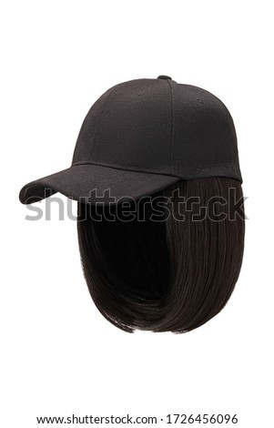 Subject shot of a natural looking dark-chestnut wig attached to a black baseball cap. The cap with the short wig is isolated on the white background.  ストックフォト ©