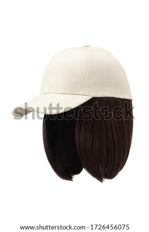 Subject shot of a natural looking dark-chestnut wig attached to a white baseball cap. The cap with the short wig is isolated on the white background.  ストックフォト ©