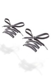 Subject shot of gray shoe strings with reflective stripe. The plane shoe laces with thin tips are tied in a bow and hanging in the air on the white background.