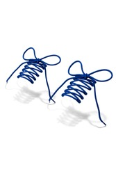 Subject shot of indigo blue shoe strings with thin tips. The plaited shoe laces are tied in a bow and hanging in the air on the white background.