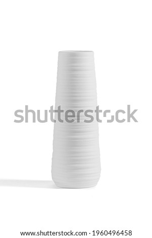 Subject shot of white ceramic vase with fluted surface. Elongated Scandinavian bowl is isolated on the white background.  Foto stock ©