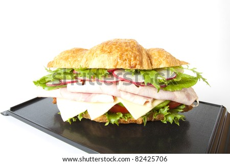 submarine, big submarine ham and cheese croissant sandwich.