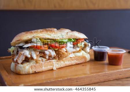 Shutterstock Submarine sandwich fried chicken with extra sauces