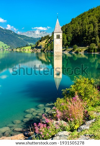 Submerged Bell Tower of Curon at Graun im Vinschgau on Lake Reschen in South Tyrol, Italy Stock photo ©