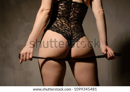 submissive girl waiting for punishment. spanking. bdsm theme.